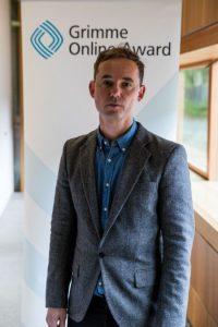 """Bastian Asdonk von """"Germania"""" bei der Bekanntgabe der Nominierungen zum Grimme Online Award. Foto: Grimme-Institut / Arkadiusz Goniwiecha"""